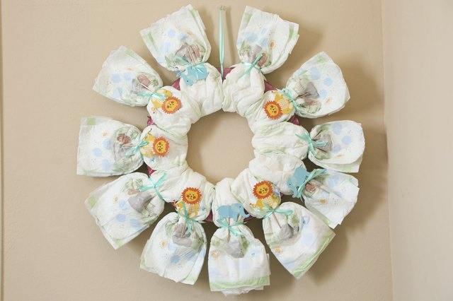 Baby Gift Ideas Using Diapers : How to make baby shower gifts out of diapers steps ehow