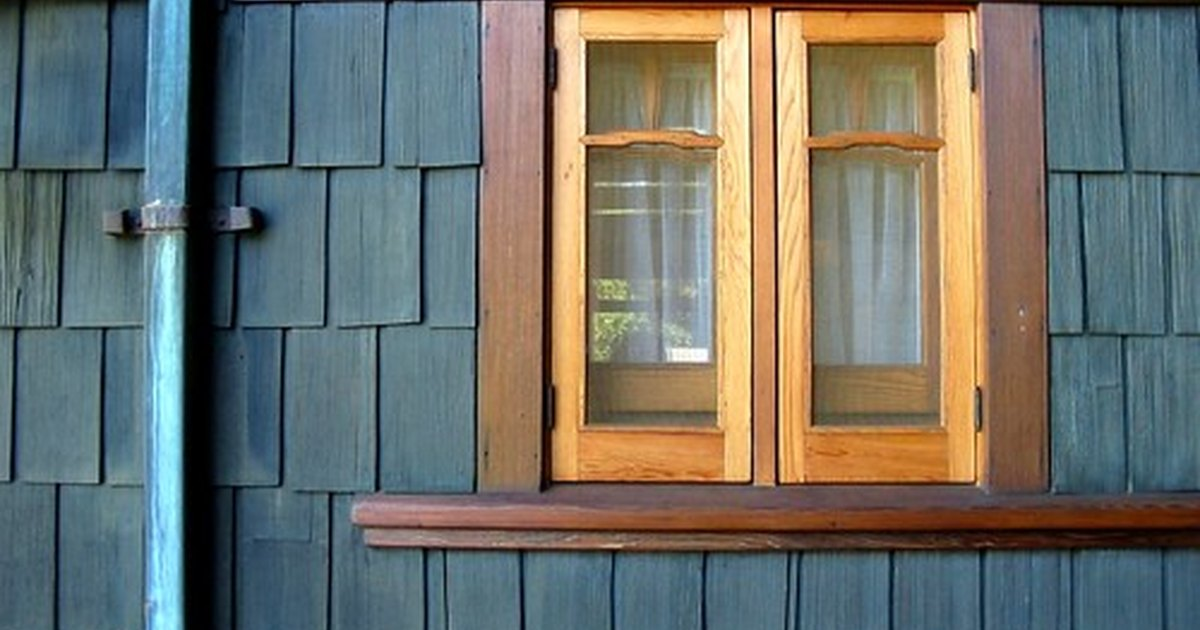 Exterior wood paint vs stain ehow uk - Painting wood siding exterior decor ...