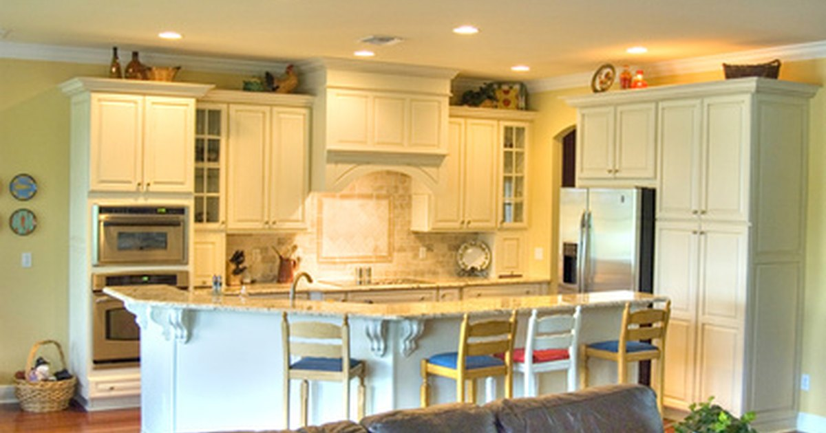 How to reface your kitchen cabinet doors ehow uk for Can i restain my kitchen cabinets