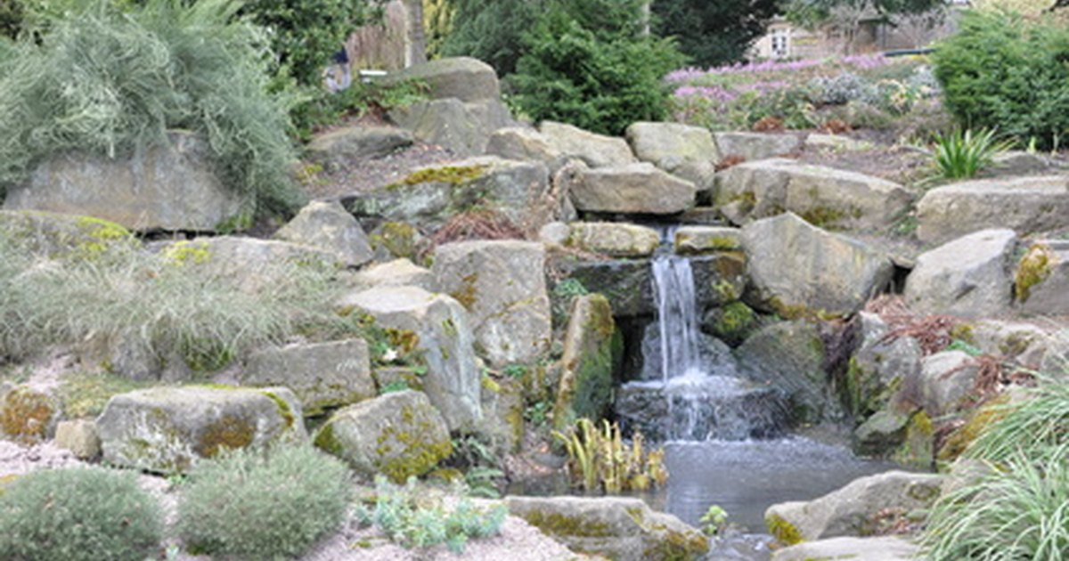 How to build a waterfall using a waterfall box ehow uk for Building a goldfish pond