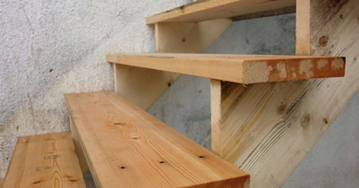 How to use pre cut stair stringers for decks ehow uk for Pre built stairs interior