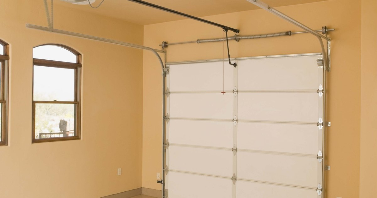 How to adjust an overhead garage door spring ehow uk for How to adjust garage door spring