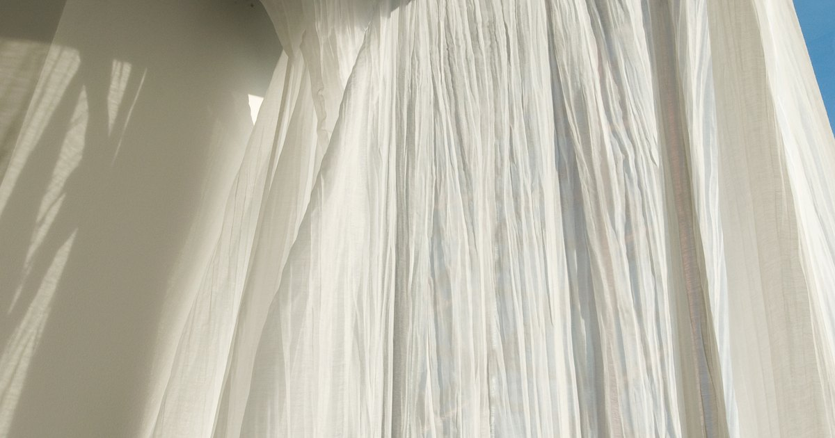 Instructions for sewing curtain panels together ehow uk - White bedroom with flowing curtains ...