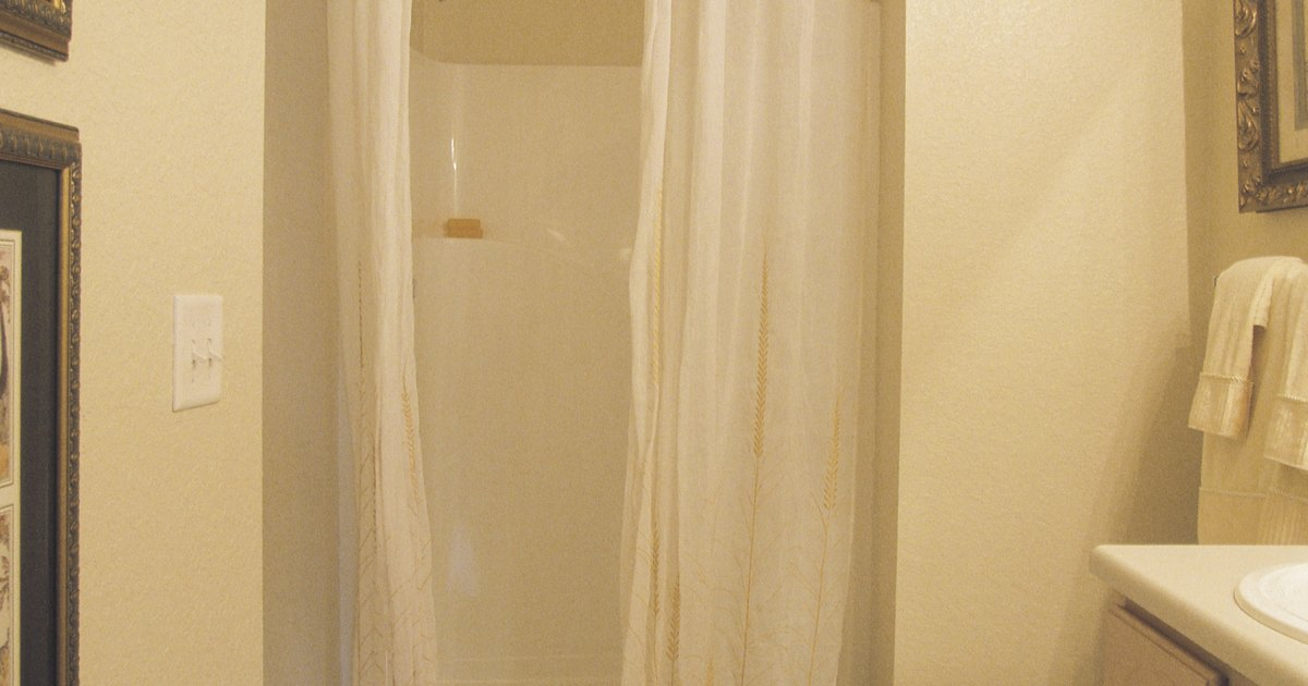 how to keep water from leaking outside a shower curtain