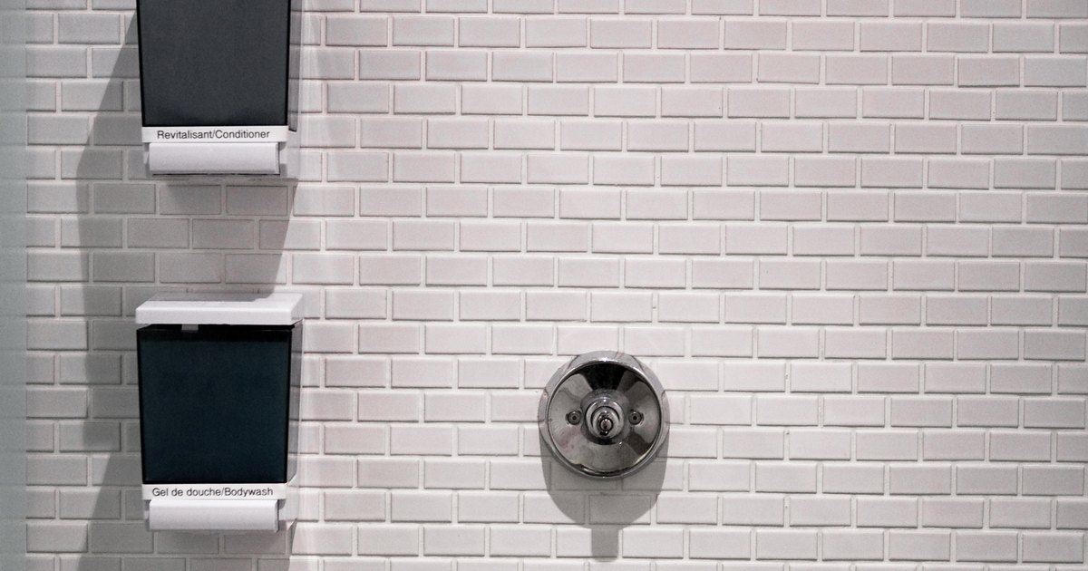 how to fix shower leak in wall