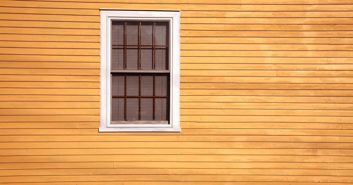 Types of clapboard house siding ehow uk for Types of wood siding for houses